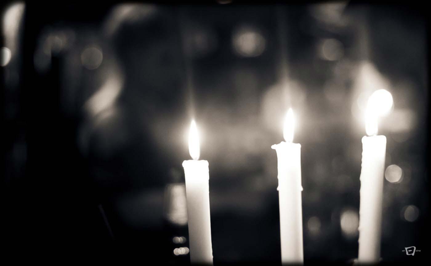 Three candles in a pub.